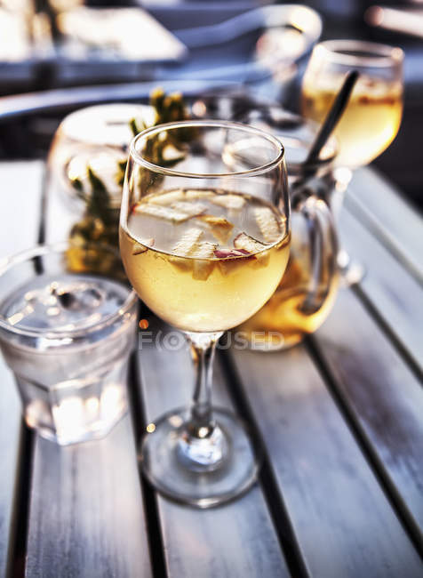 Wine glasses and jug of cocktails — Stock Photo