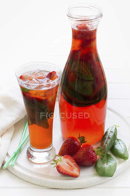 Carafe and glass of infused soft drink — Stock Photo