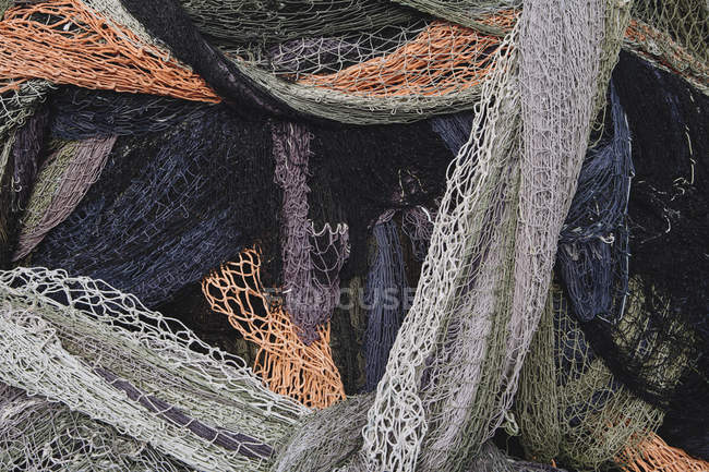 Pile of tangled up commercial fishing nets — Stock Photo