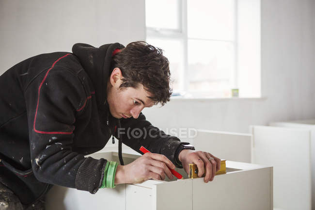 Builder, holding a pencil and ruler — Stock Photo