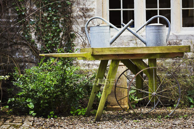 Old fashioned wooden wheel barrow — Stock Photo