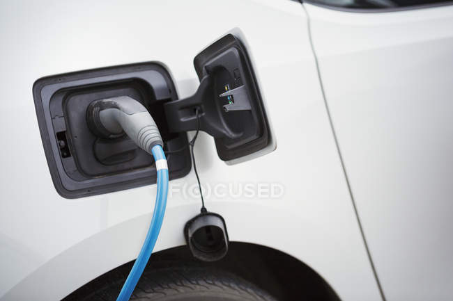 Electric car being charged — Stock Photo