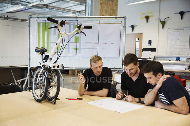 Men in a meeting at a bicycle factory, — Stock Photo