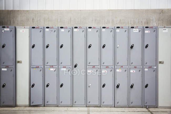 Row of grey metal lockers — Stock Photo