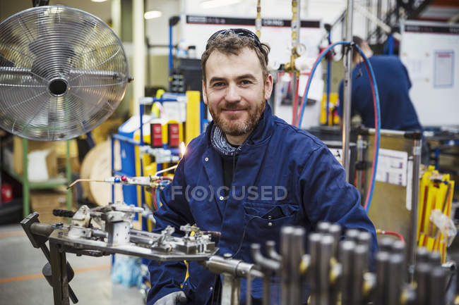 Skilled factory worker — Stock Photo