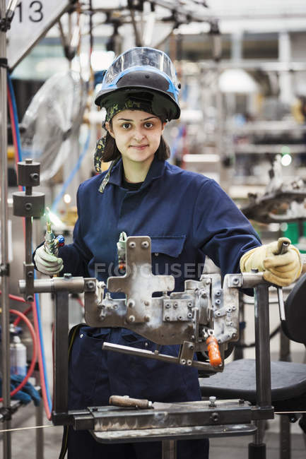 Female skilled factory worker — Stock Photo