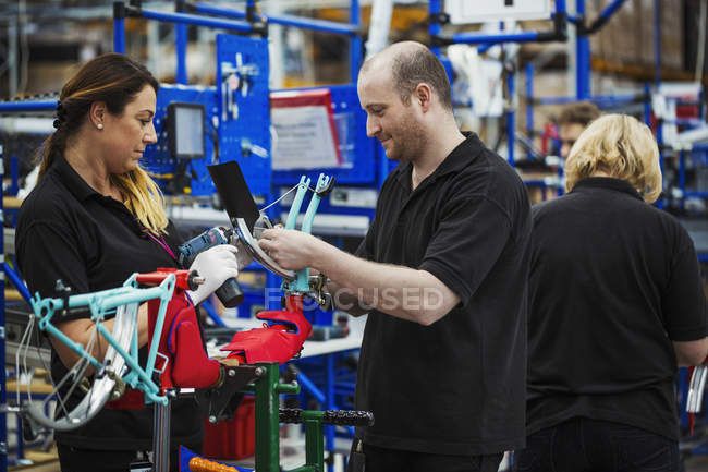 Three cycle factory workers — Stock Photo