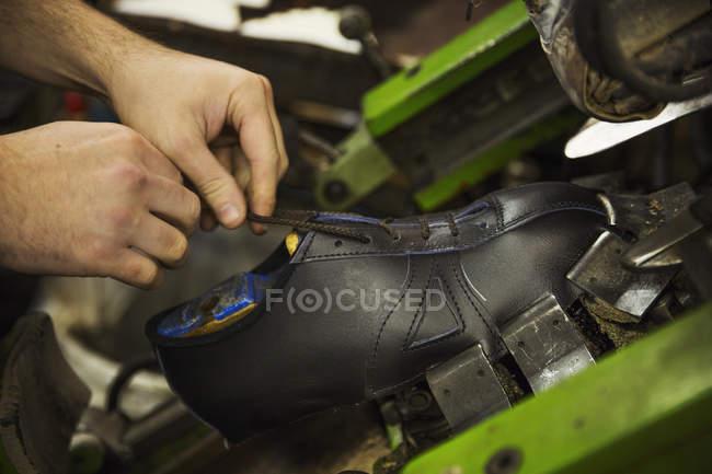 Man tying laces of leather shoe. — Stock Photo