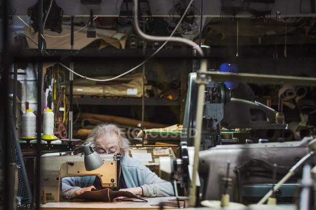 Senior grey haired woman worker — Stock Photo