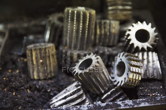 Various shaped metal cogs — Stock Photo