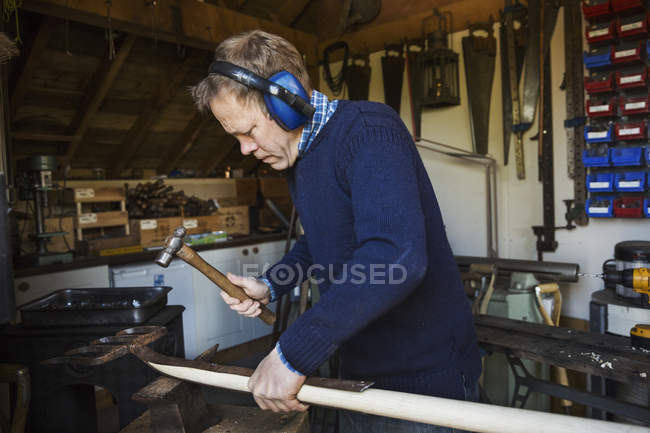 Man standing in workshop — Stock Photo
