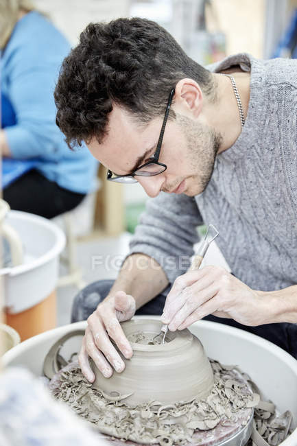 Man seated at a potter's wheel — Stock Photo