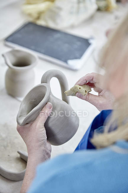 Woman shape and smooth jug — Stock Photo