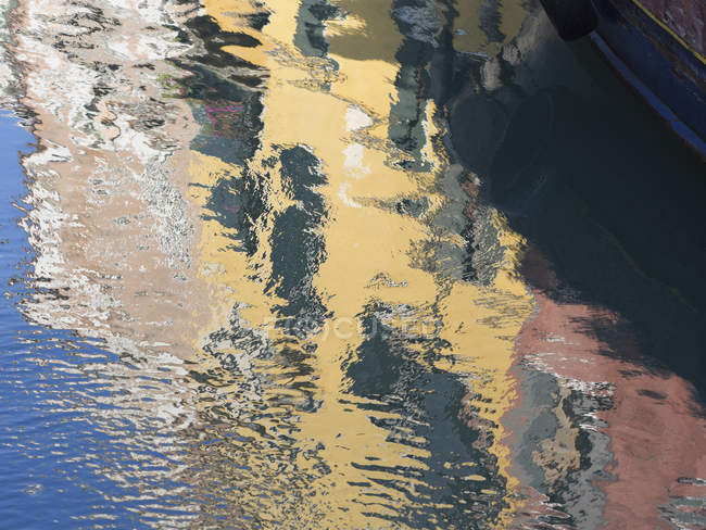 Reflection of houses with painted walls — Stock Photo
