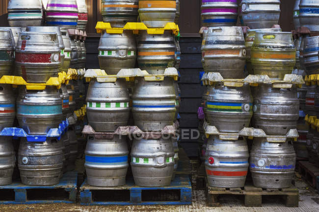 Stacks of metal beer kegs — Stock Photo