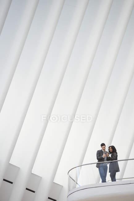 People standing on balcony — Stock Photo
