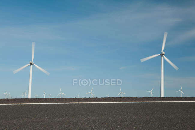 Wind turbines, tall white towers — Stock Photo