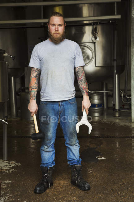 Man standig in a brewery — Stock Photo