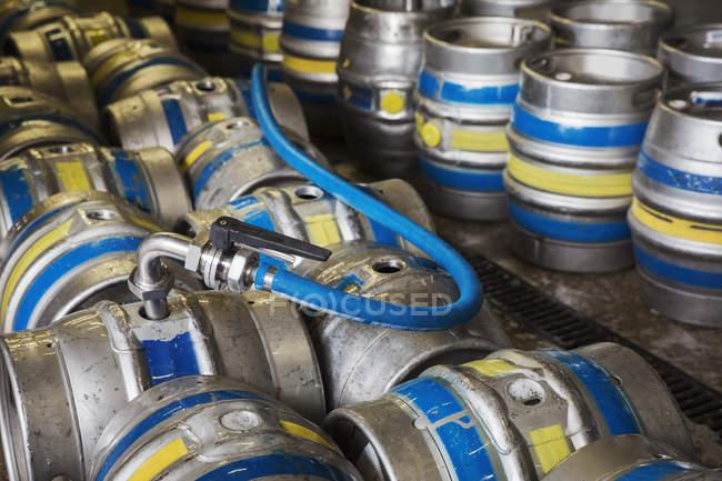 Metal beer kegs being filled — Stock Photo