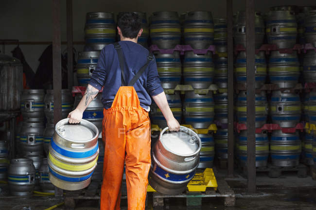 Man working in brewery — Stock Photo