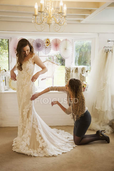 Bride selecting her dress — Stock Photo