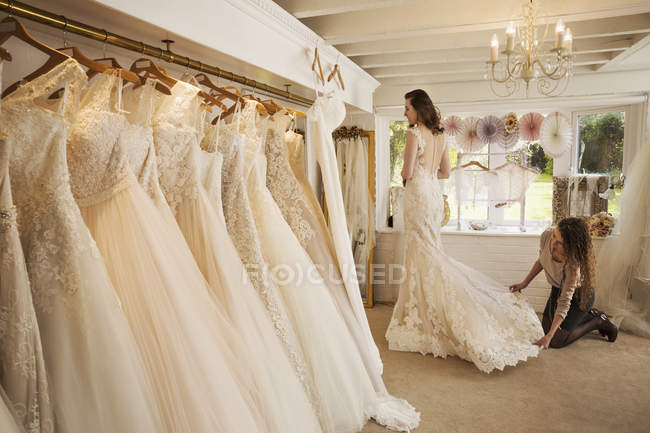 Rows of wedding dresses on displa — Stock Photo
