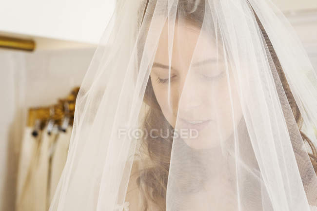 Woman trying on net bridal veil — Stock Photo