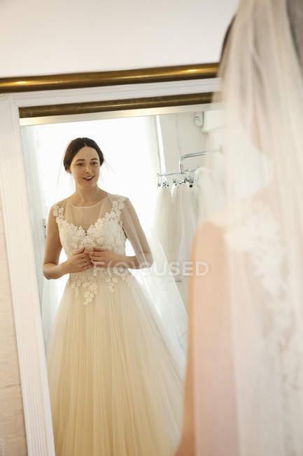 Woman in a wedding dress — Stock Photo