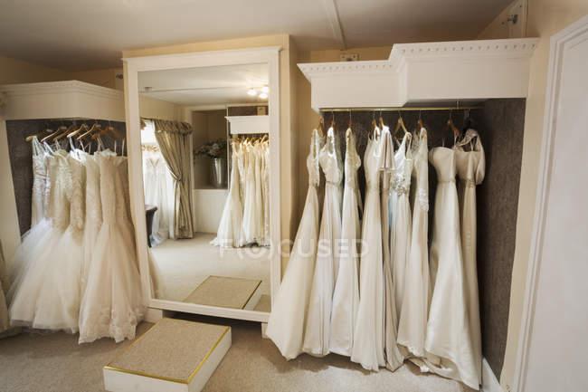 Rows of wedding dresses on display — Stock Photo