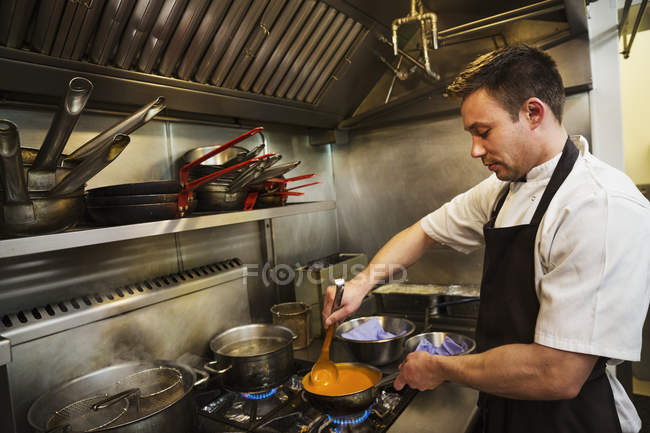 Chef standing in kitchen — Stock Photo