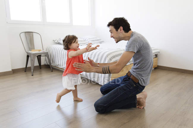 Man playing with baby girl — Stock Photo