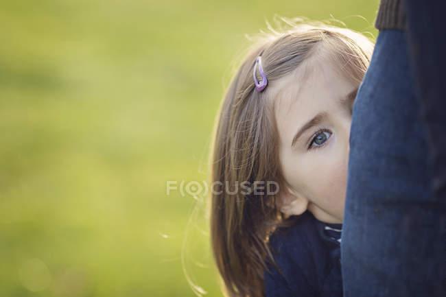 Girl peering at camera — Stock Photo