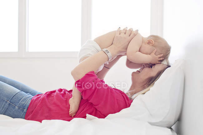 Mother touching foreheads with daughter — Stock Photo