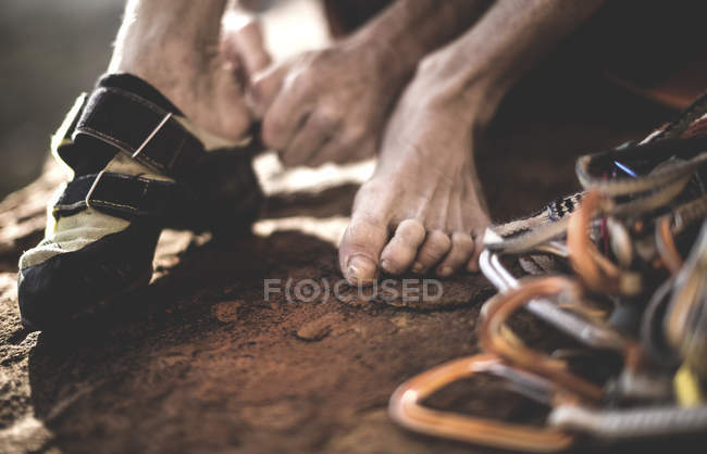 Climber putting on rock climbing shoes — Stock Photo