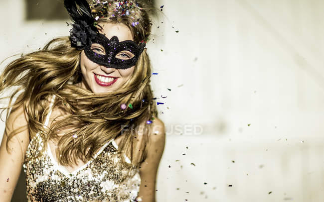 Young woman at confetti party. — Stock Photo