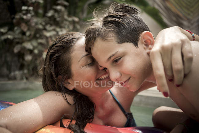 Woman and a boy cuddling — Stock Photo