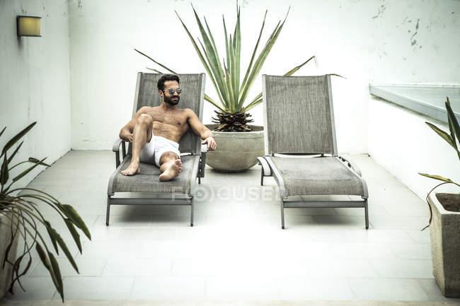 Man lying on sun lounger. — Stock Photo