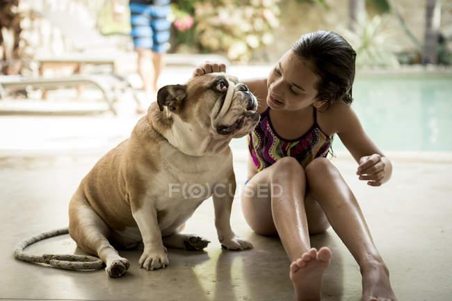 Girl petting dog. — Stock Photo