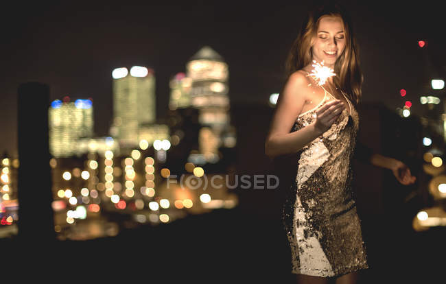 Young woman in sequined party dress — Stock Photo