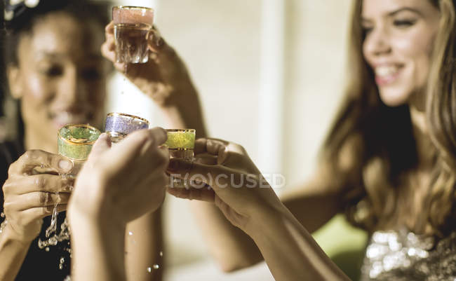 Women at party in sequined dresses — Stock Photo