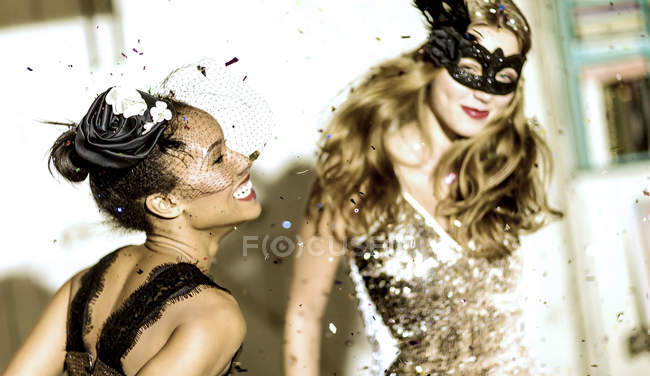 Young women dancing and smiling. — Stock Photo