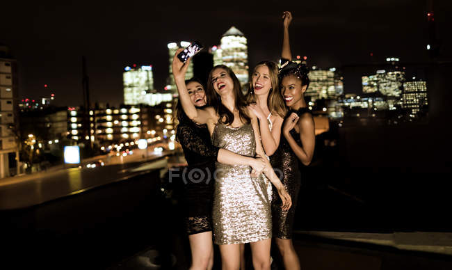 Women on rooftop posing for photograph. — Stock Photo