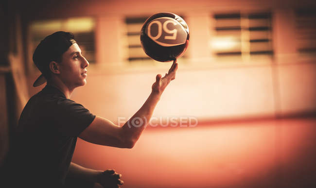 Man balancing ball on fingertip. — Stock Photo