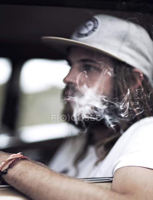 Bearded man wearing baseball cap — Stock Photo