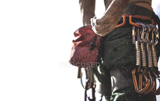 Mountaineer reaching back to pouch of chalk — Stock Photo
