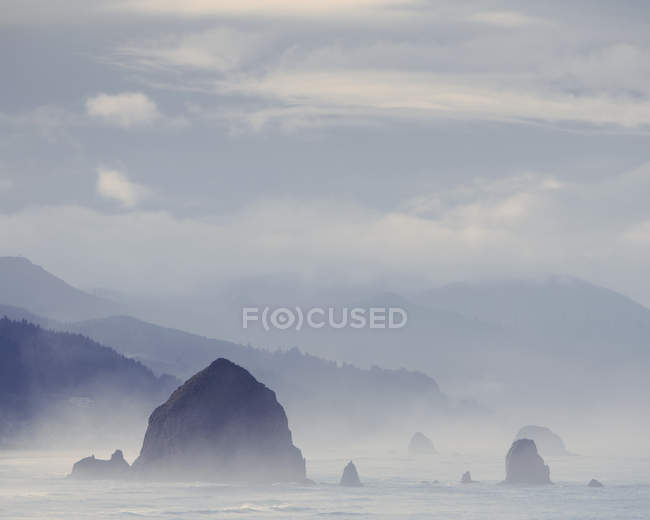 Foggy view of Haystack Rock — Stock Photo
