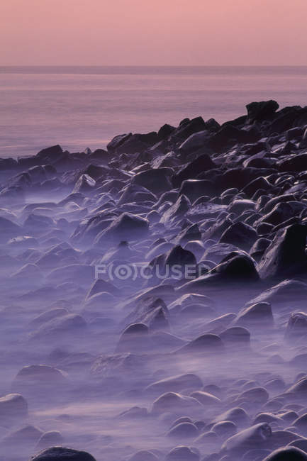 Rocky beach at twilight at Galapagos Islands — Stock Photo