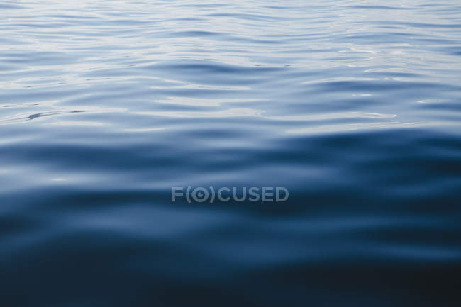 Surface of ocean water with ripple, full frame — Stock Photo