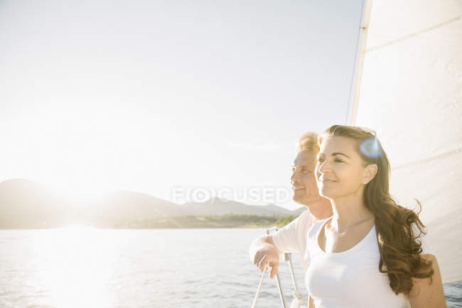 Man and woman enjoying sunlight on sailboat. — Stock Photo