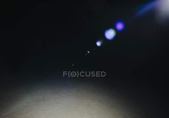 Light refractions at night on desert playa of Black Rock Desert, Nevada. — Stock Photo